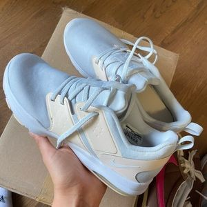 Light blue nike athletic shoes